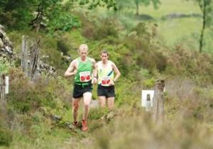 Runners running The Coed Y BRenin Marathon